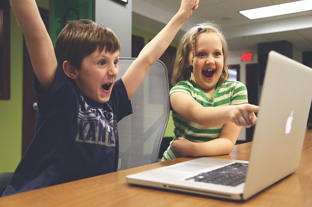 children having fun on a computer